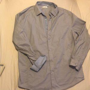 Gray button up men's shirt by Alex Vando